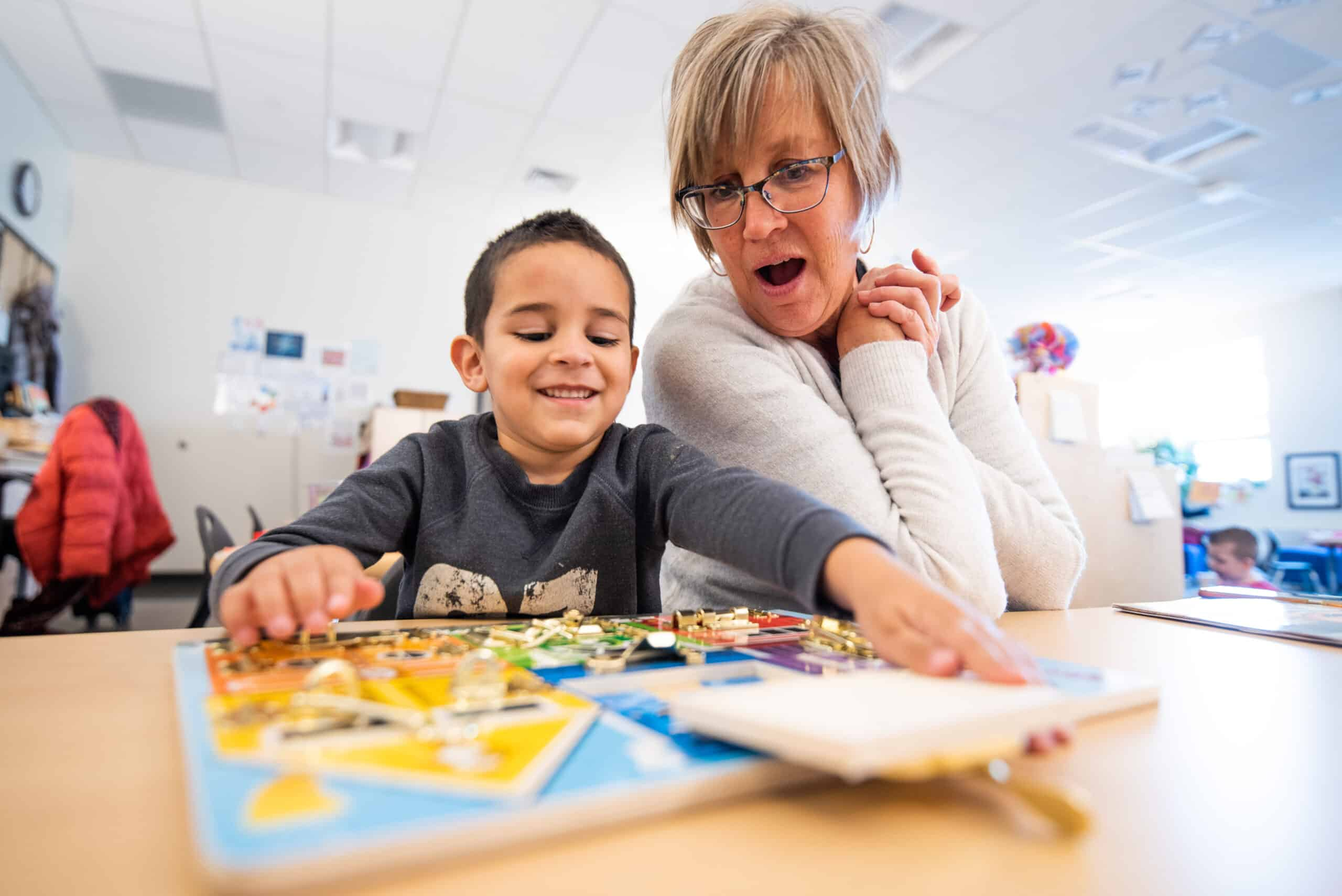 Grand View Elementary preschooler and Joan Scheuerman learning together