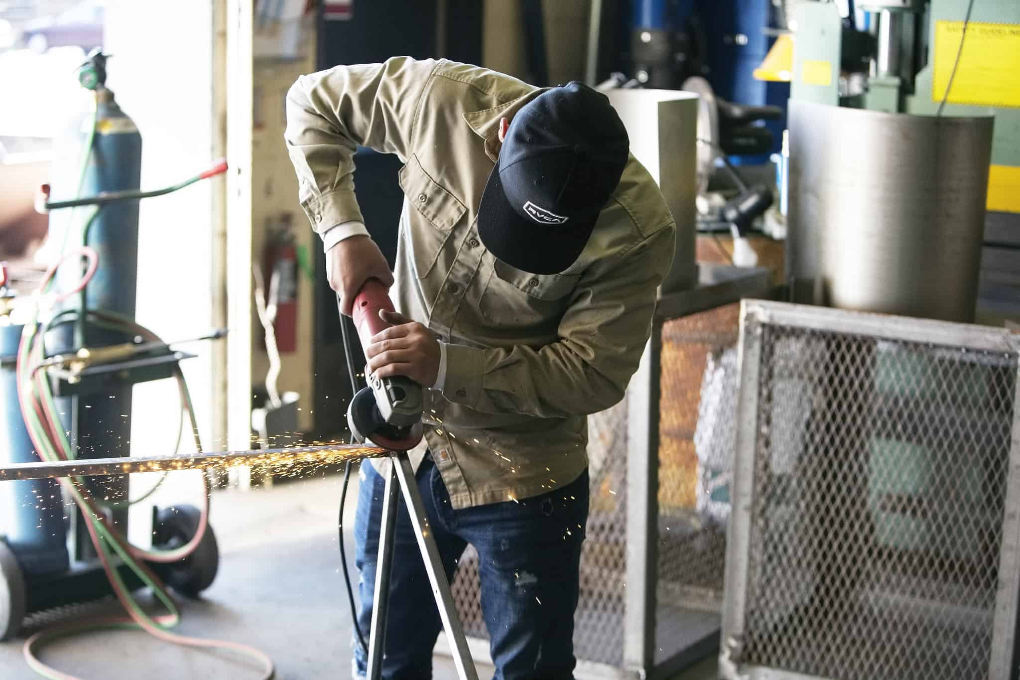 A student welding at the Career Development Center