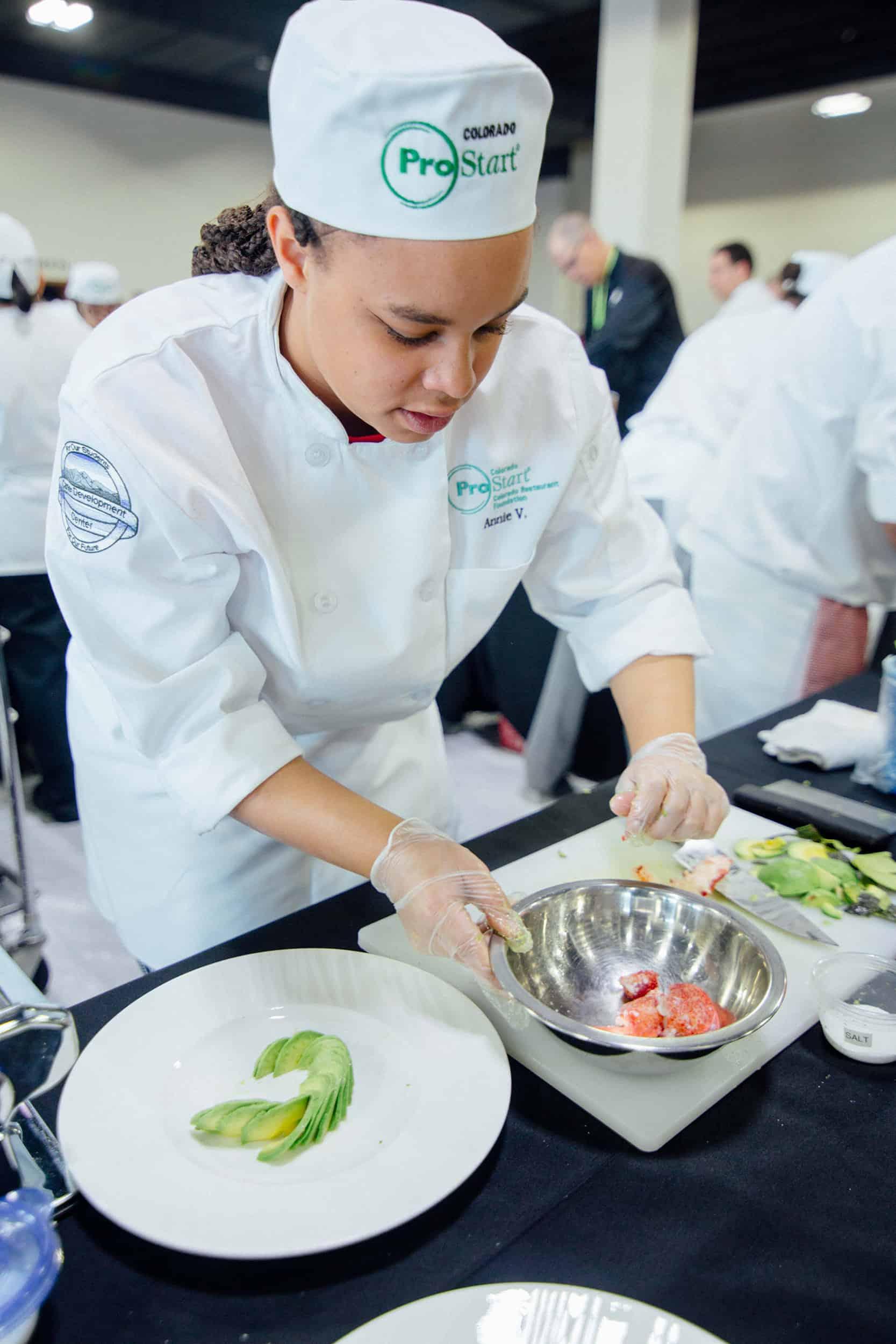CDC culinary student prepares an avocado salad