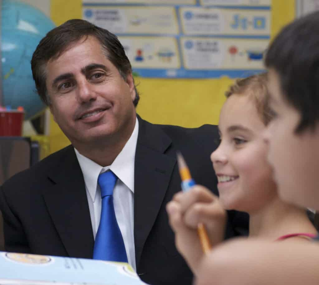 Photo of Don Haddad with students.