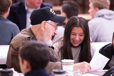 Student and veteran interacting