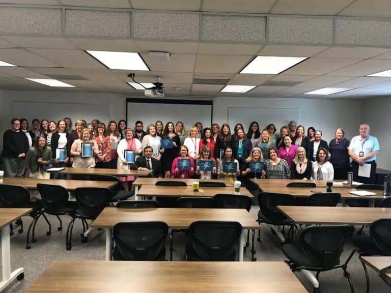 A large group of Student Services staff members with Superintendent Don Haddad