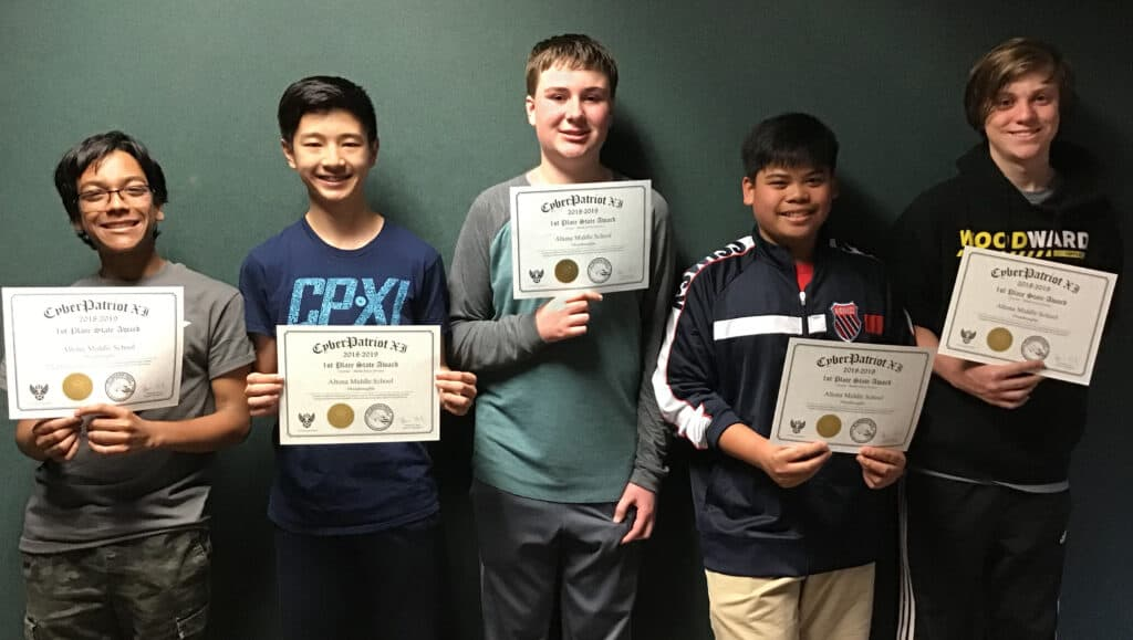 Five students at Altona Middle School holding up their Cyber Patriot Awards.