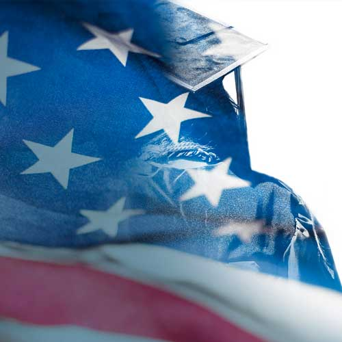Graduating student with an American flag overlay
