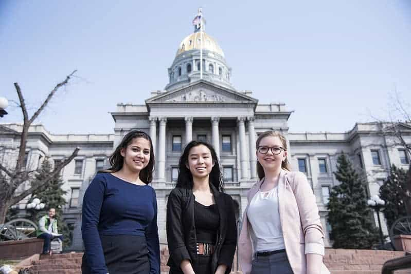 Three Skyline students at the Colorado state Capitol building