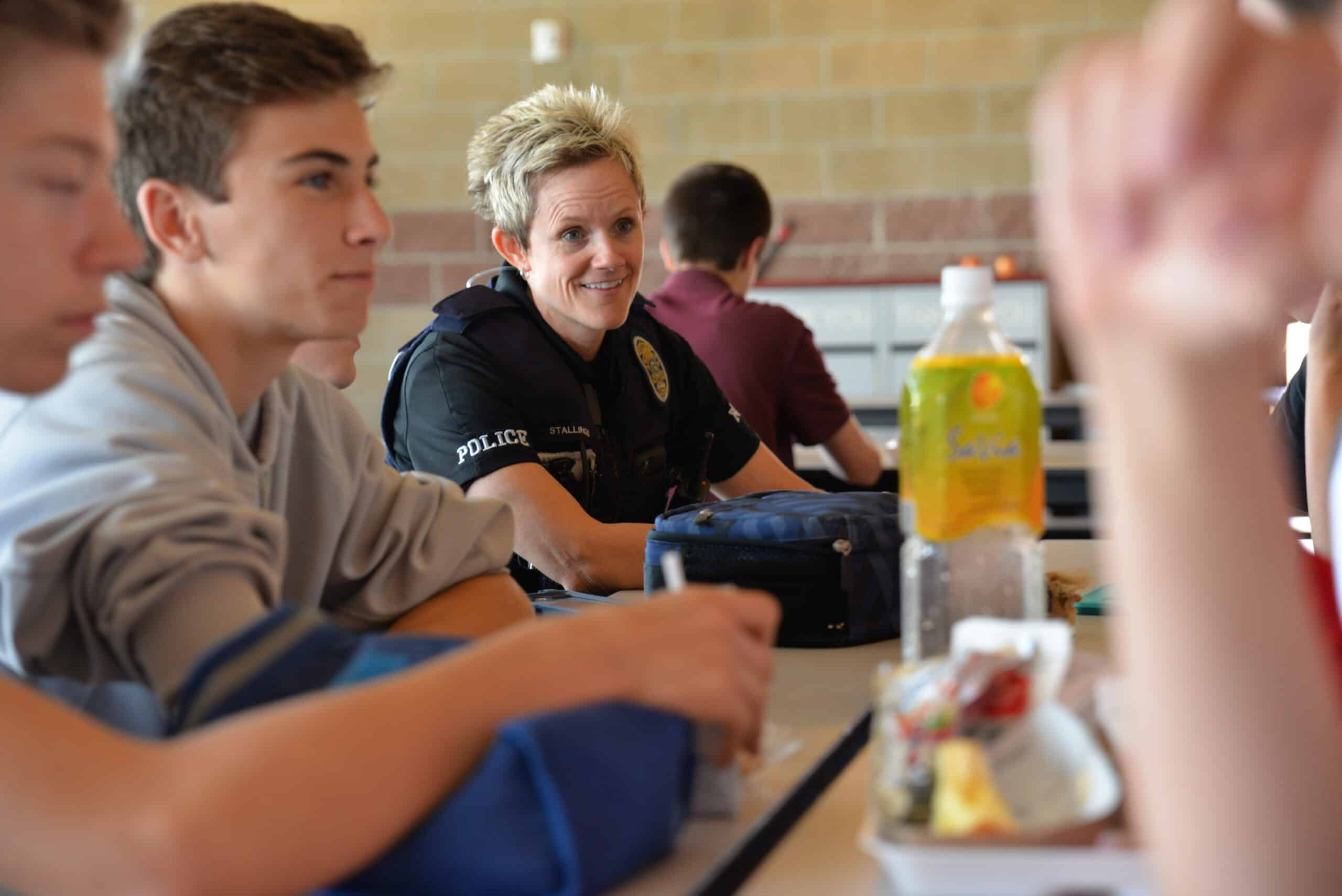 School Student Resource Officer having lunch with students