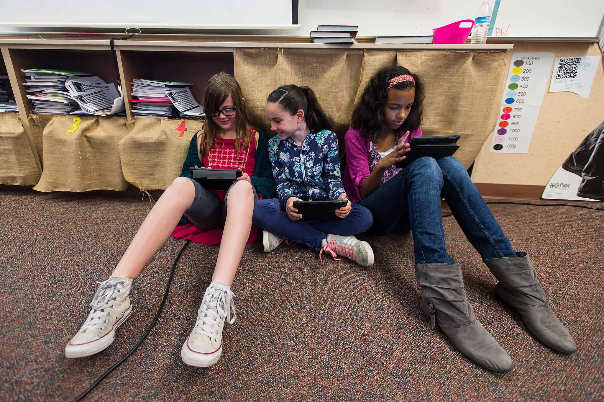 three girls working on their ipads