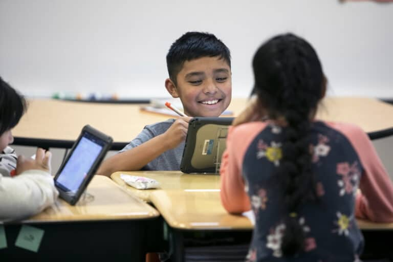 Elementary student working on an iPad