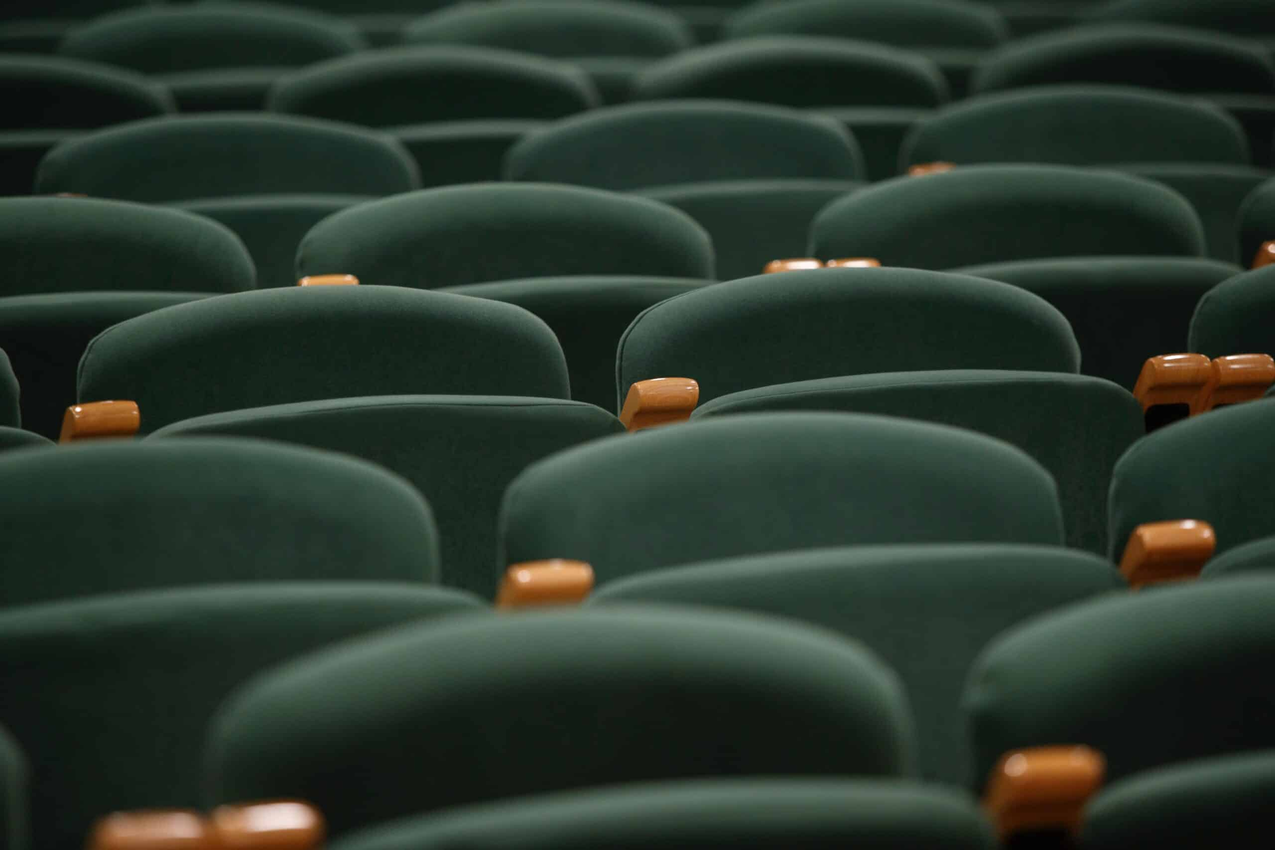 Green theater chairs in an auditorium