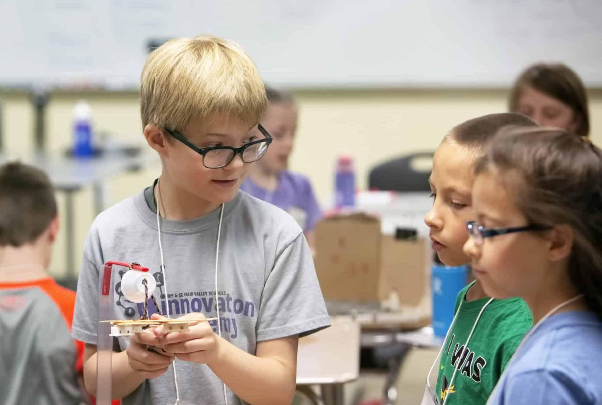 Boy building crane during Innovation Academy summer program