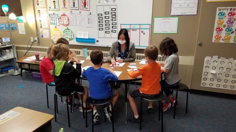 Teacher working with students during Dragon Time